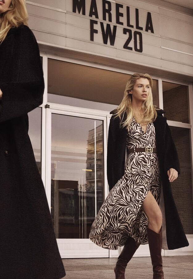 modelka Stella w płaszczu i kozakach