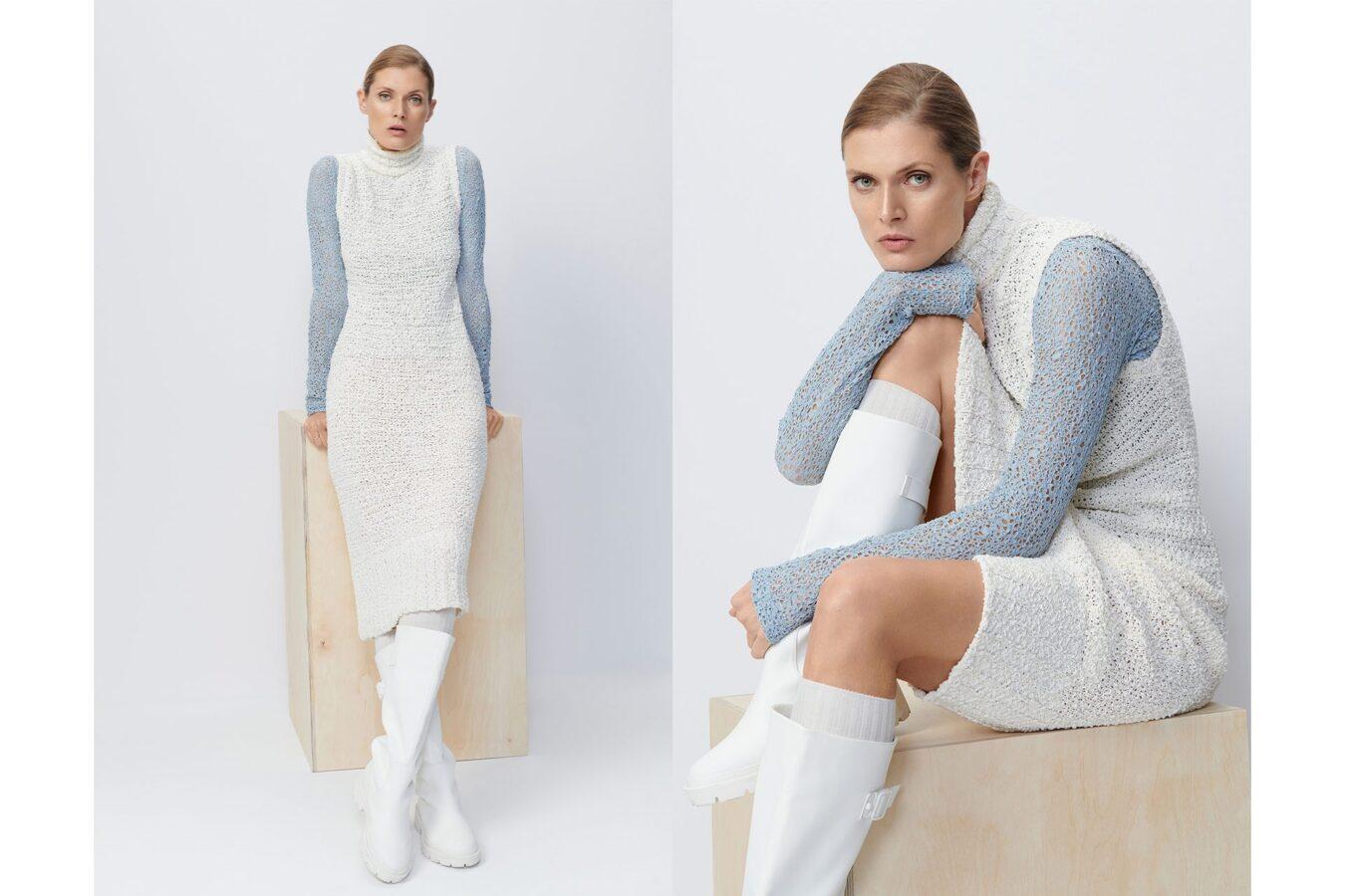 modelka w białej sukience i niebieskim swetrze